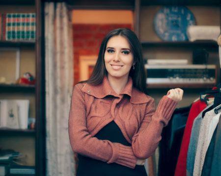 Fashionable Girl in Elegant Vintage Clothing Store