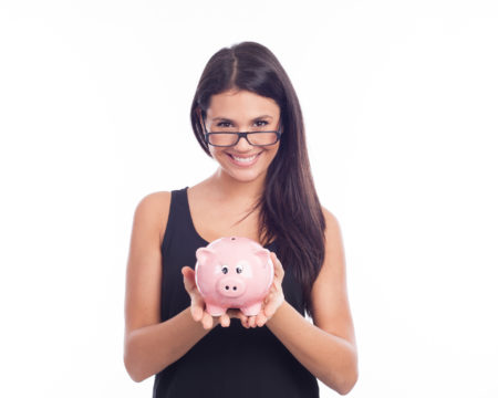 Young woman with glasses happy with piggy bank
