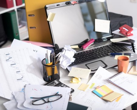 Messy and cluttered desk