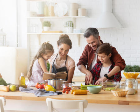 Happy family cooking together on home kitchen