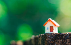 Closeup miniature house on green nature background