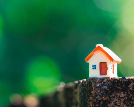 Closeup miniature house on green nature background